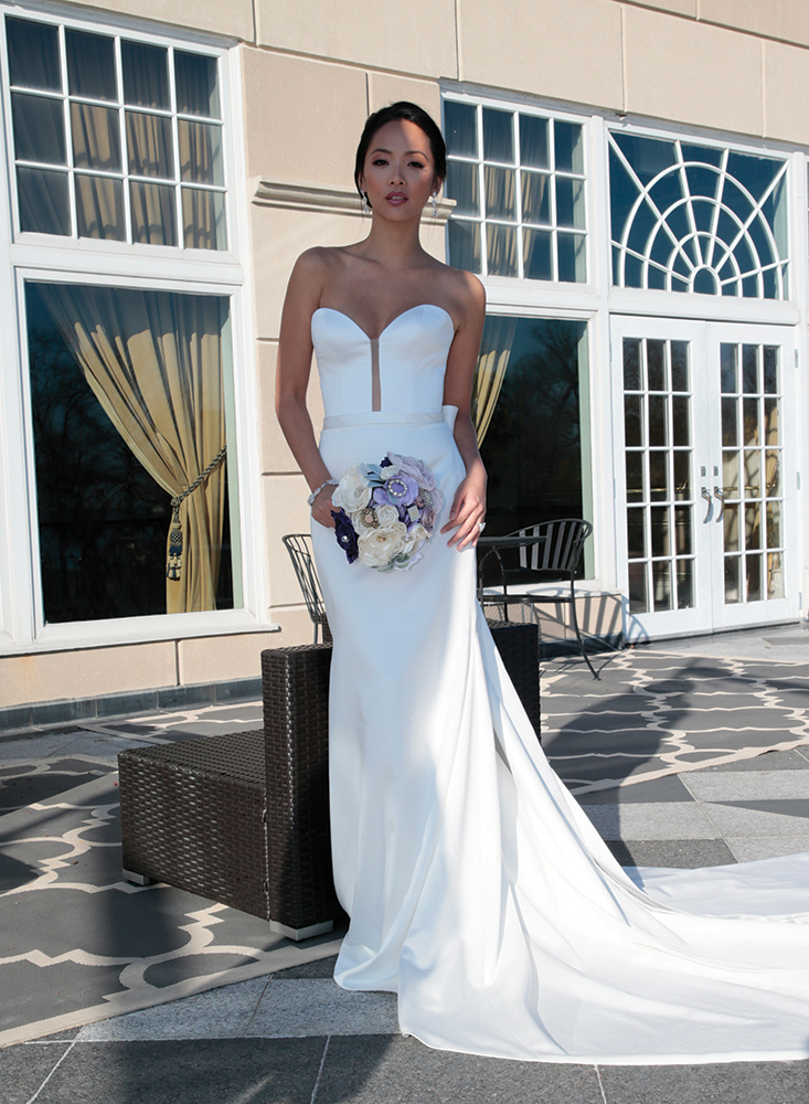 Gown: Jude Jowilson (Kelly). Bouquet: Forever Brooch Bouquets.