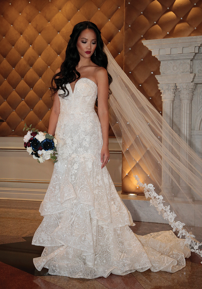 Gown: Oleg Cassini (CWG846, $1499) at David's Bridal. Bouquet: Forever Brooch Bouquets.