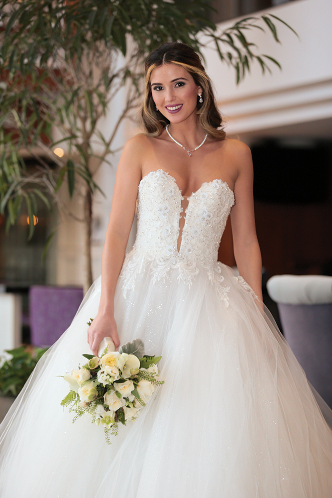 Gown: Eve of Milady (4381). Bouquet: Ariston Flowers.