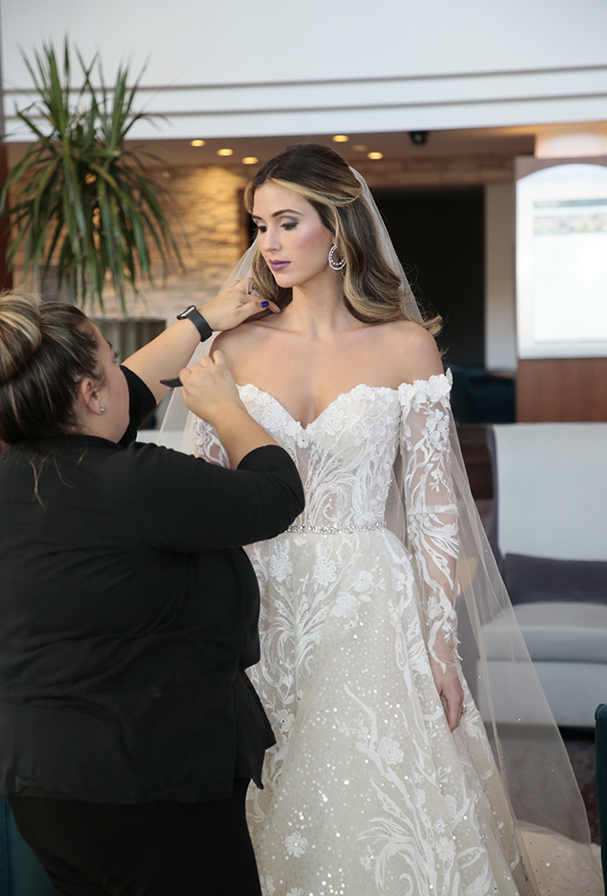 Pre-Shoot Touch Up. Gown: Eve of Milady. (4388) Bouquet: Ariston Flowers.
