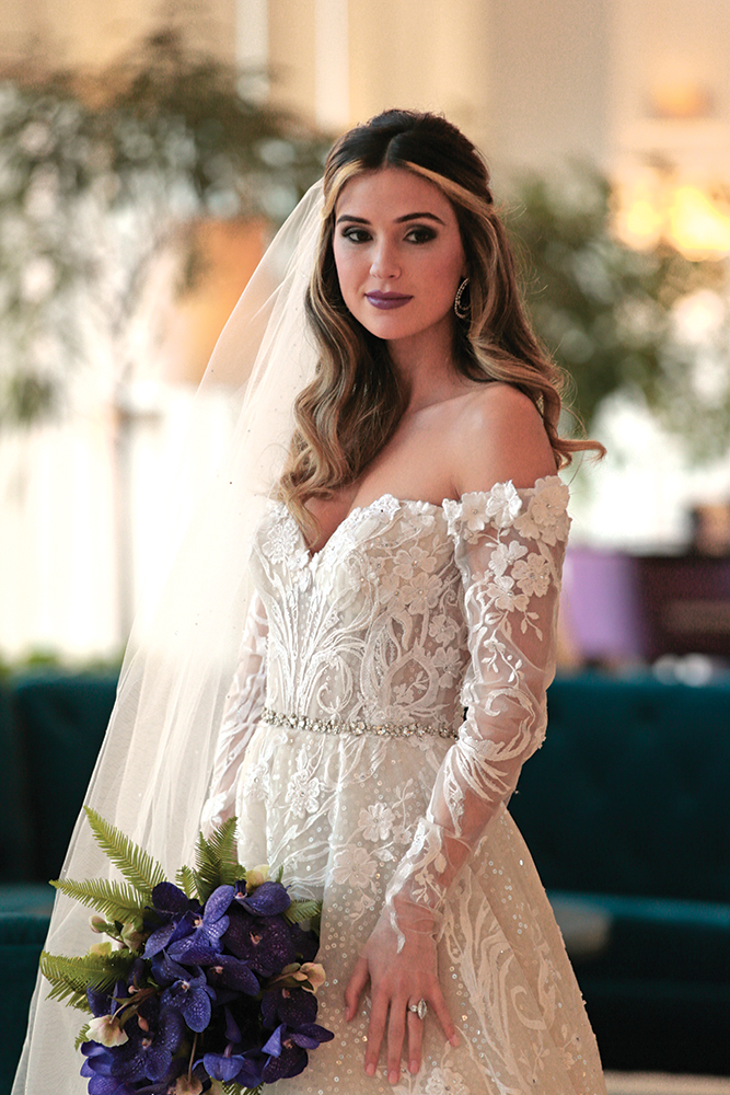 Gown: Eve of Milady (4388). Bouquet: Ariston Flowers.