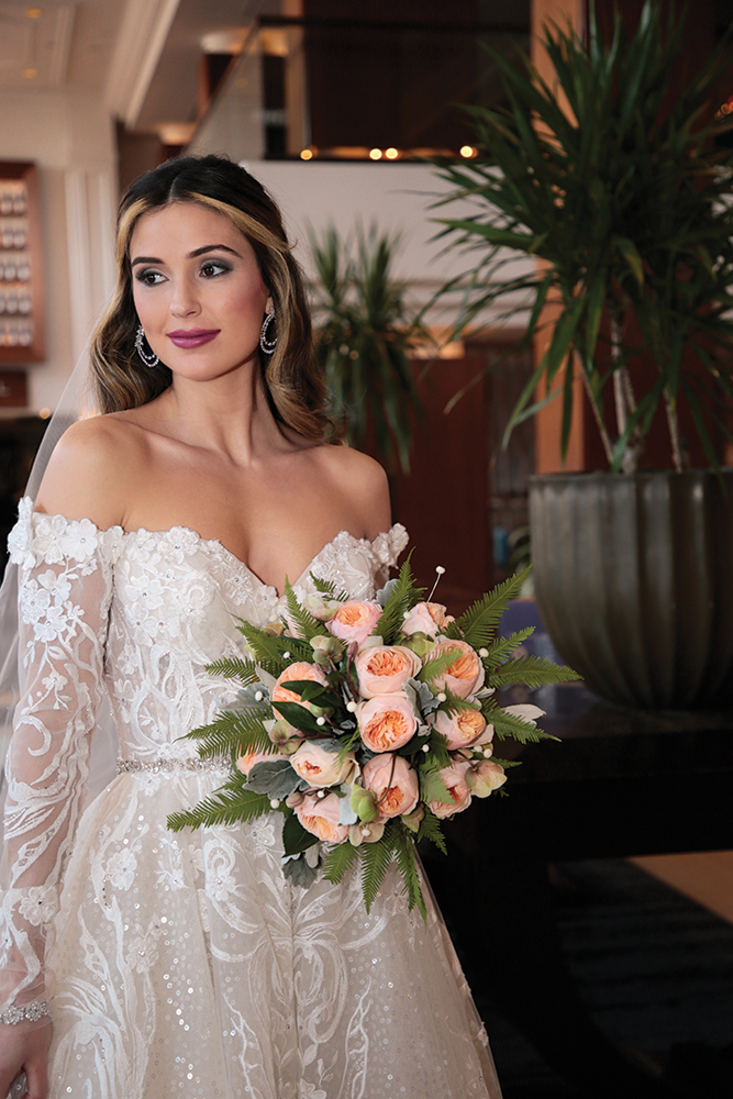 Gown: Eve of Milady (4388) Bouquet: Ariston Flowers