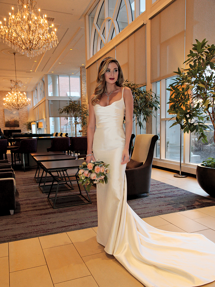 Gown: Jude Jowilson (Taylor). Bouquet: Ariston Flowers.