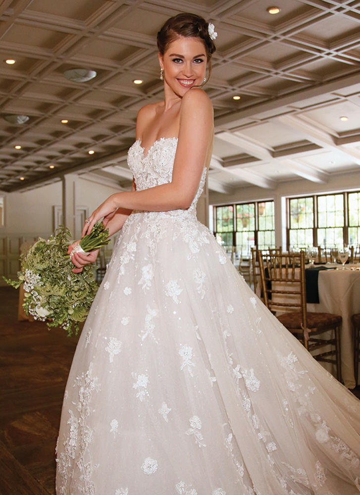 Maria at Hotel du Village. Gown: Eveof Milady (367). Bouquet: Douglas Koch Designs