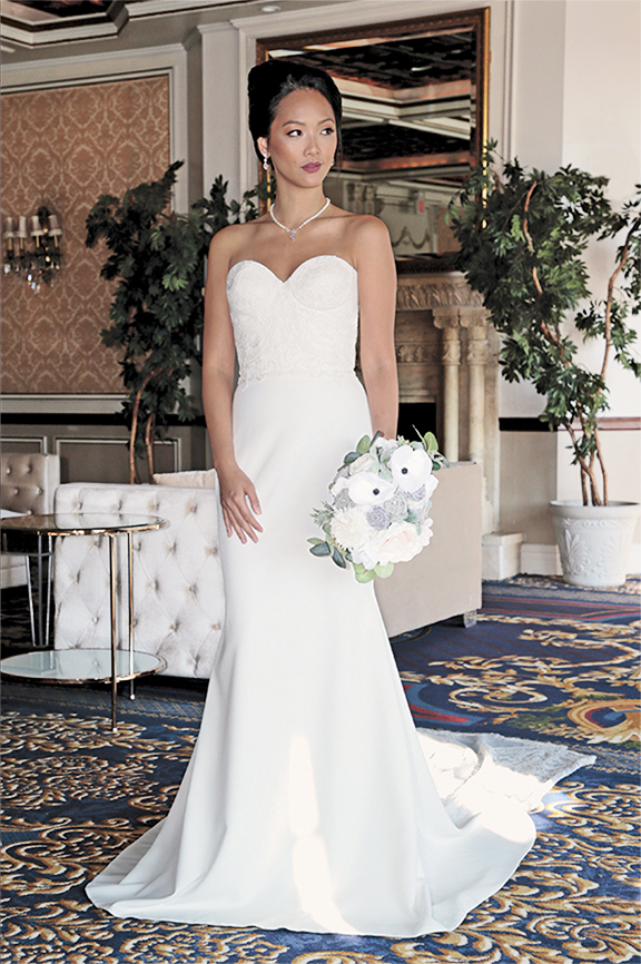 Gown: Jude Jowilson (Swanson). Bouquet: Forever Brooch Bouquets.