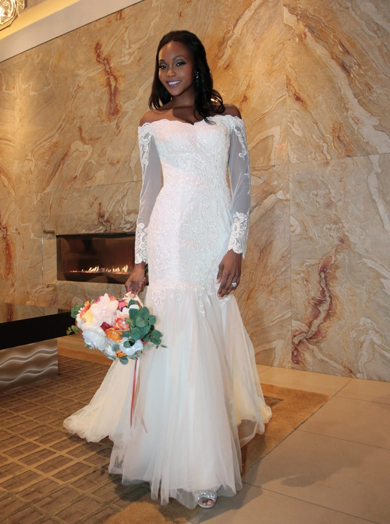 Gown: David's Bridal (WG3943, $649). Bouquet: Forever Brooch Bouquets.