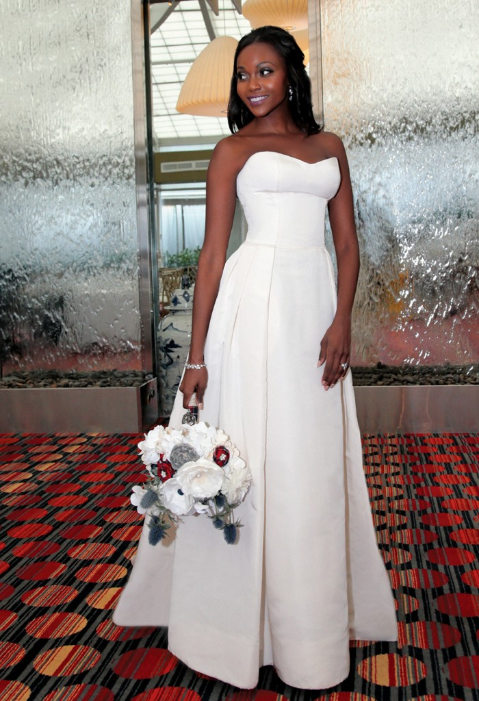 Gown: Jude Jowilson (Sabrina). Bouquet: Forever Brooch Bouquets.