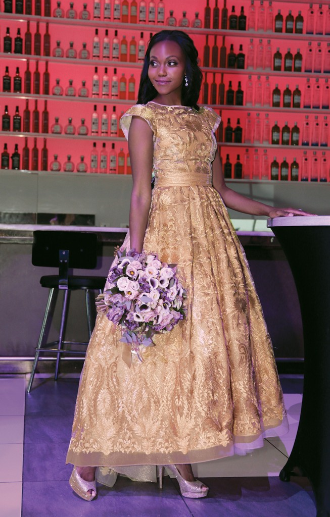 Gown: Lucia Rodriguez (LE87000, $3800). Bouquet: Douglas Koch Designs Ltd.