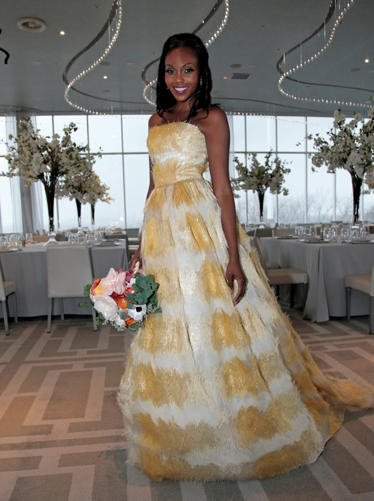 Gown: Lucia Rodriguez (LE92000, $5800). Bouquet: Forever Brooch Bouquets.