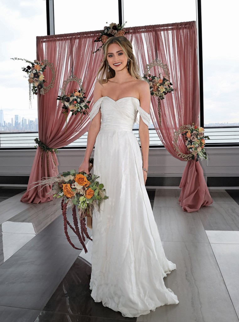 Gown: Tulle New York (Miriam, $4900) Bouquet & Ceremony Arch: Douglas Koch Designs Ltd.