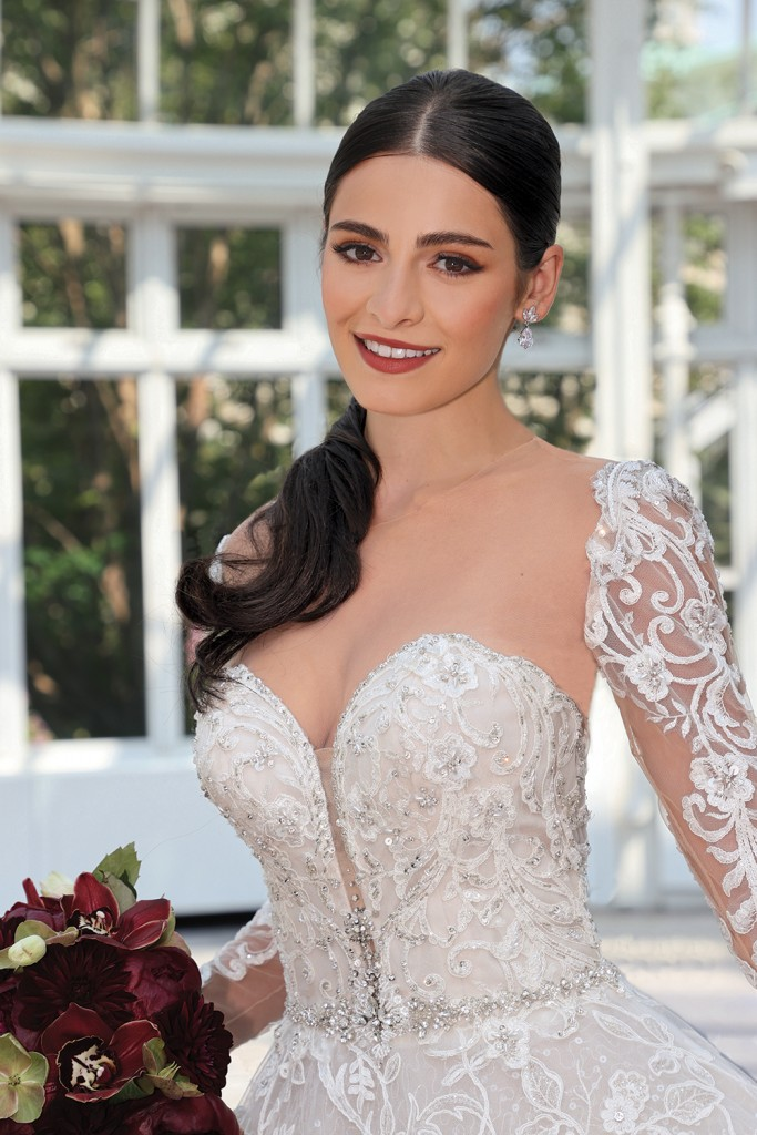 Gown: Eve of Milady (4379). Bouquet:  Ariston Flowers.