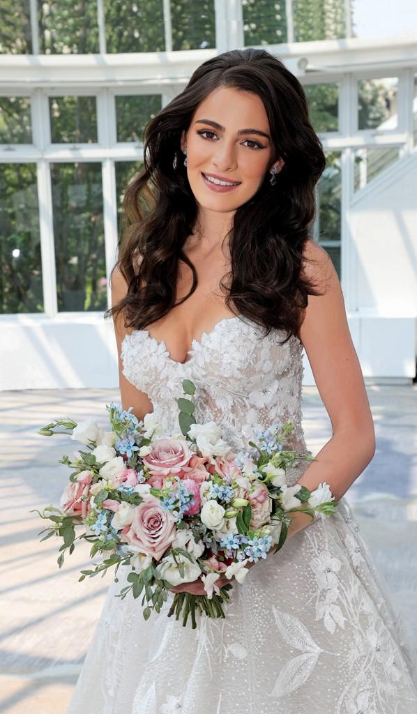 Gown: Eve of Milday (4374). Bouquet: Douglas Koch Designs Ltd.